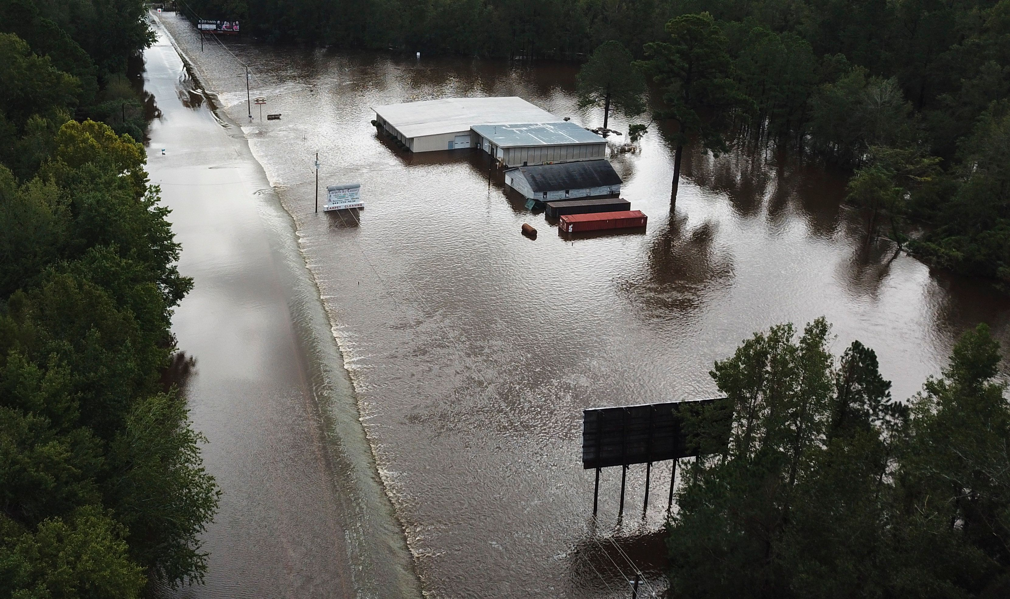 Water from The Little Pee Dee River floods business and washes out part of Rte. 301