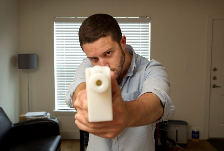 Cody Wilson shows off his first 3D-printed handgun, The Liberator, at his home in Austin, Texas, on May 10, 2013.