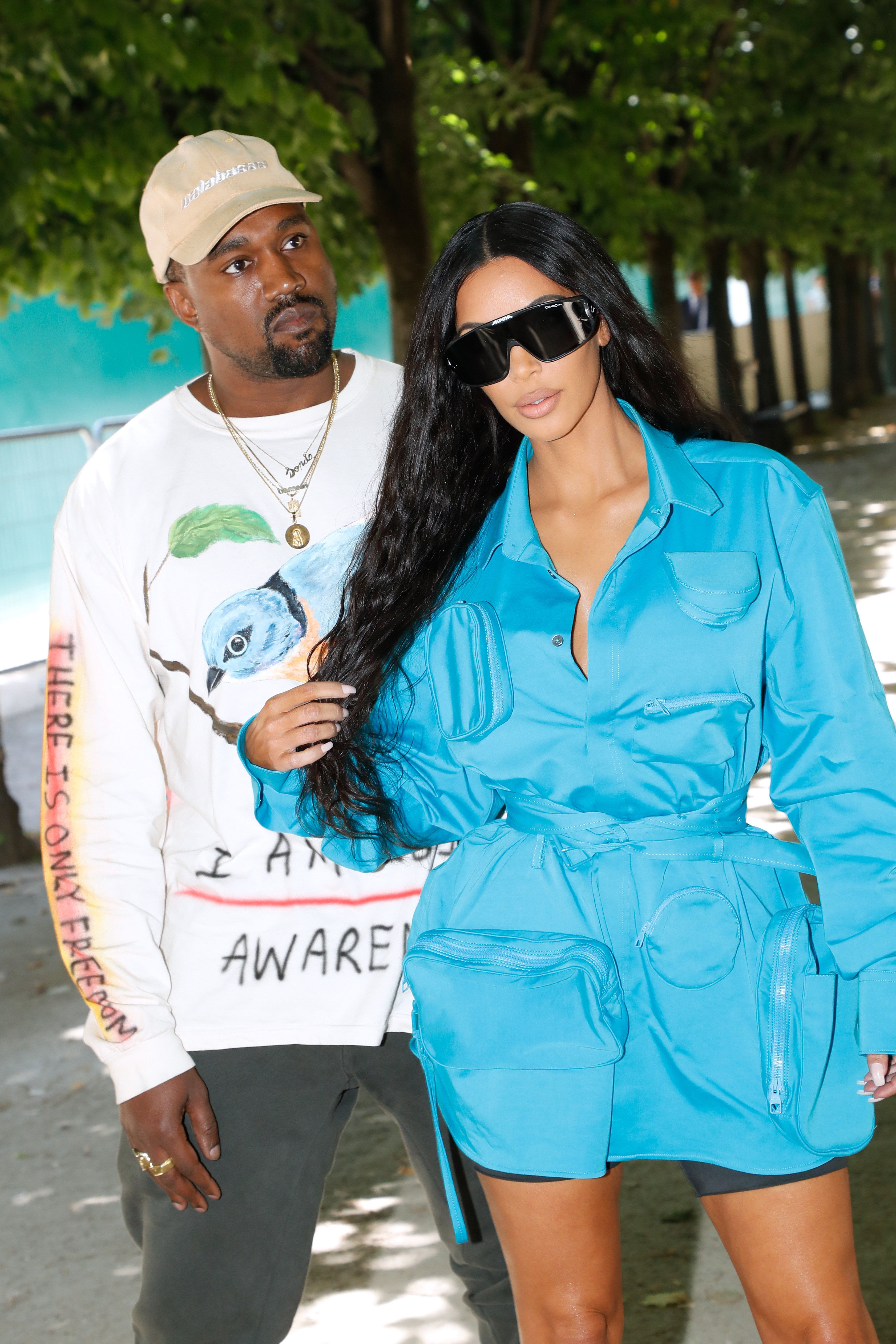 Kanye West (left) is now using Instagram to defend his wife, Kim Kardashian.