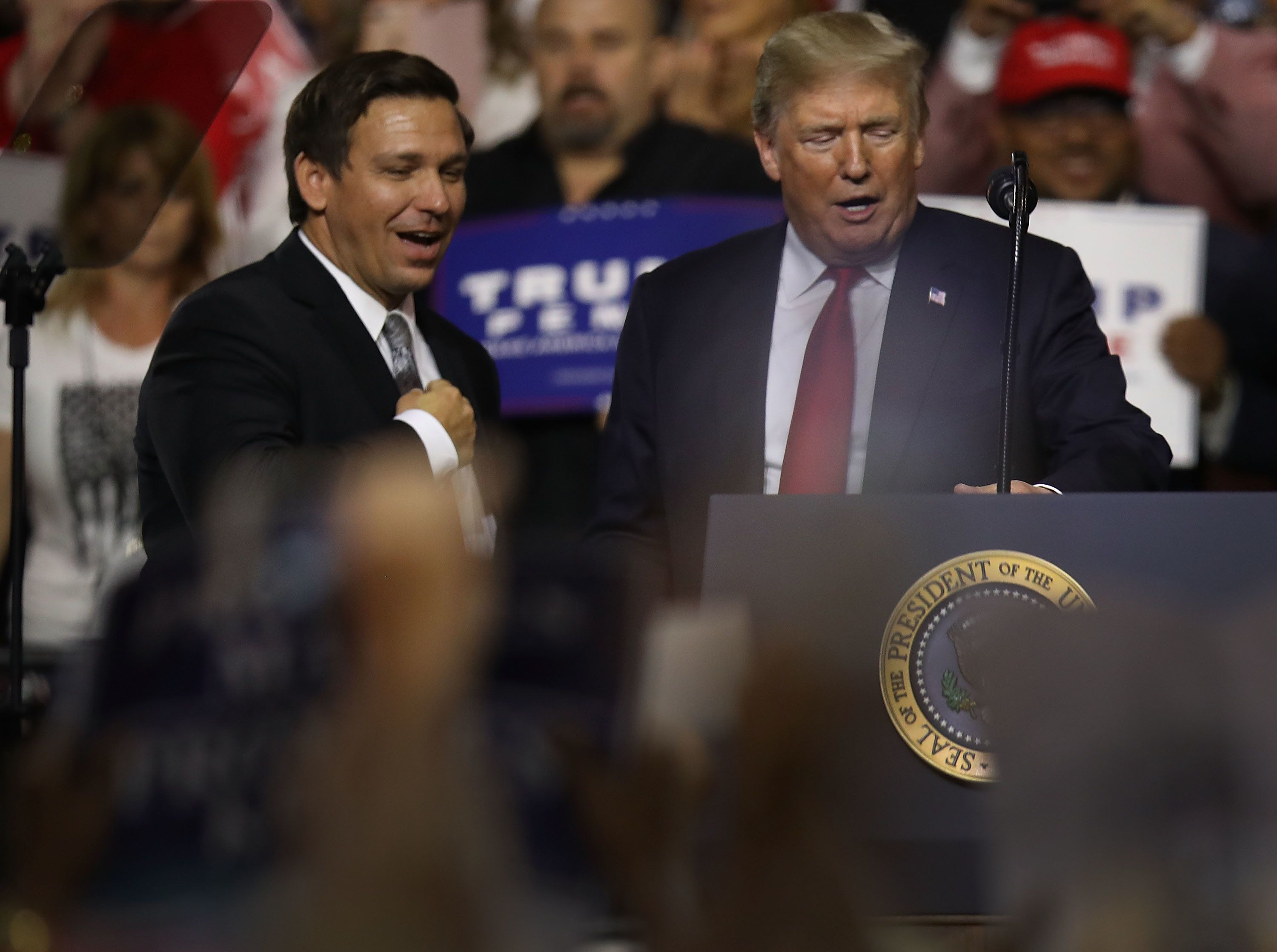 TAMPA, FL - JULY 31:  President Donald Trump stands with GOP Florida gubernatorial candidate Ron DeSantis during the president's Make America Great Again Rally at the Florida State Fair Grounds Expo Hall on July 31, 2018 in Tampa, Florida.  Before the rally, President Trump visited the Tampa Bay Technical High School for a roundtable discussion on Workforce Development in Tampa.  (Photo by Joe Raedle/Getty Images)