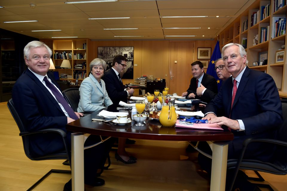 David Davis, Theresa May, European Commission President Jean-Claude Juncker and European Union's chief Brexit negotiator Michel Barnier meet at the European Commission in Brussels last year