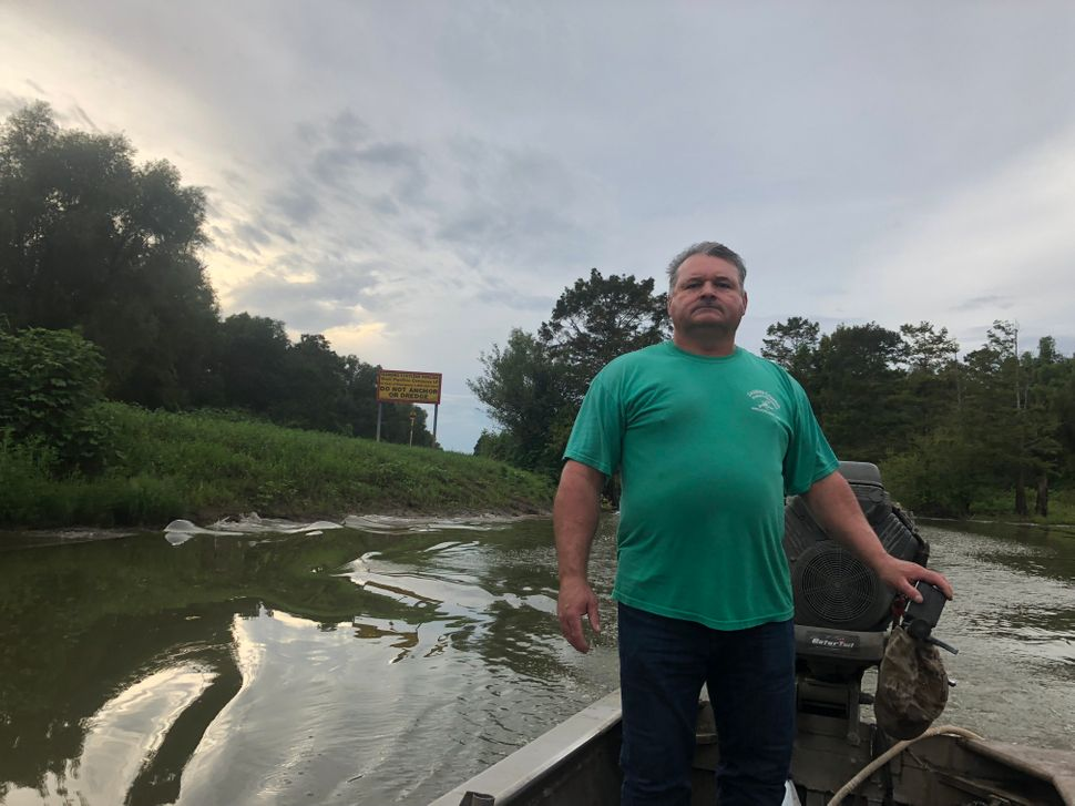 Like his father before him, Jody Meche, seen here in front of the spoil banks, was bred into crawfishing. His aptitude for it