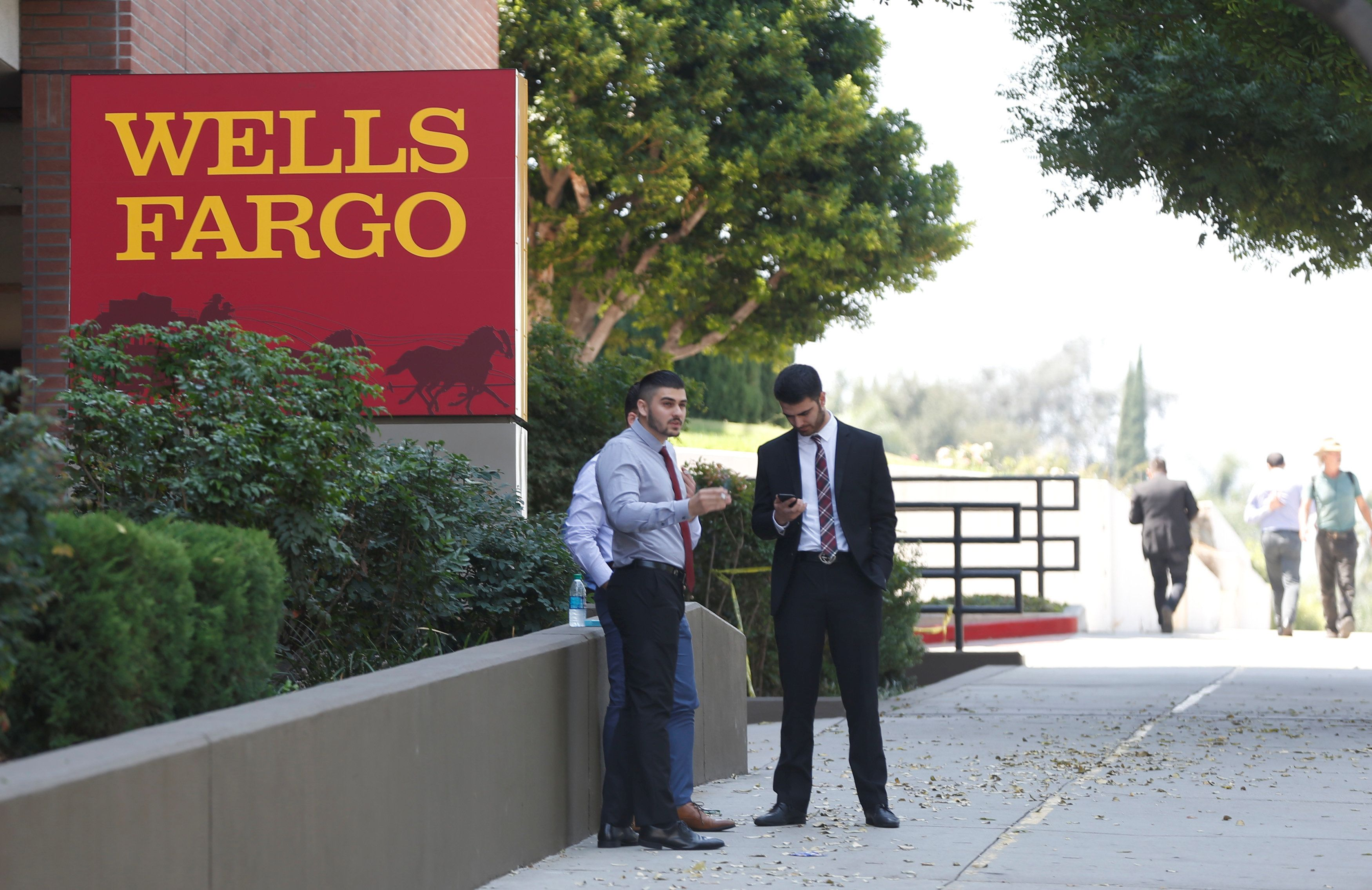 People stand by a Wells Fargo banking location in Pasadena, California, U.S., September 8, 2017. REUTERS/Mario Anzuoni