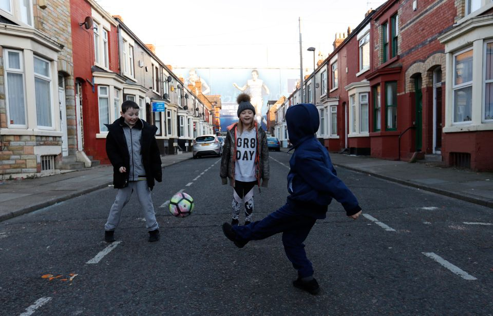 Children playing in the street near Goodison Park football stadium in Liverpool