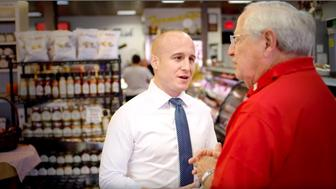 Democrat Max Rose speaks to a small business owner in Staten Island New York