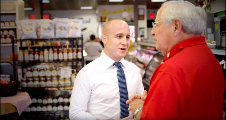 Max Rose, center, a Democrat running in New York's 11th Congressional District, is among the candidates who believe anti-corr
