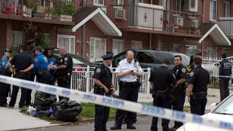Police gather outside a daycare center in a private home, after a stabbing in the Queens borough of New York, U.S., September 21, 2018.   REUTERS/Lloyd Mitchell