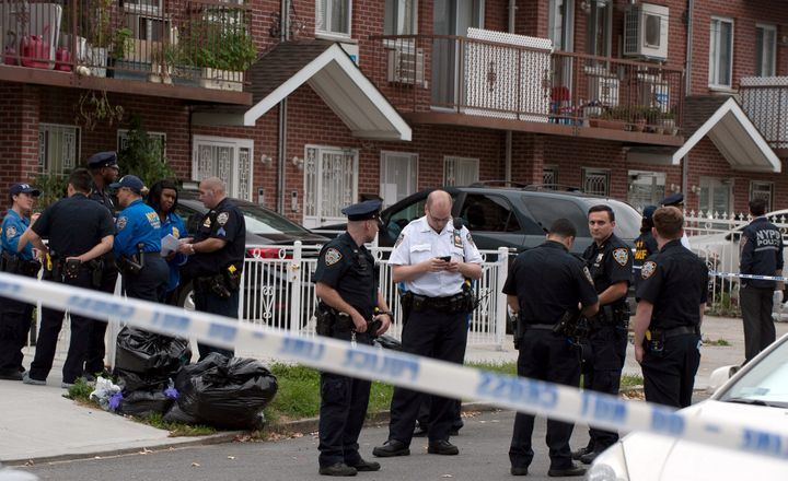 Police gather outside the daycare center, located in a private home in New York City.