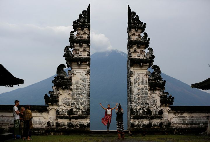 Tourists visit Lempuyang temple which overlooks the Mount Agung volcano, in Karangasem, Bali, Indonesia, Dec. 3, 2017.