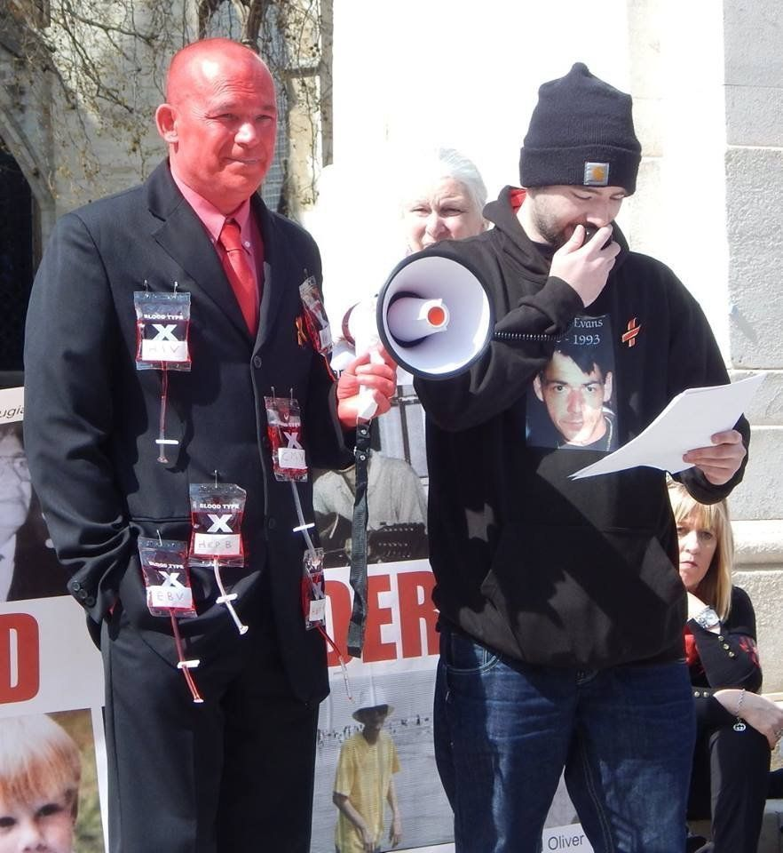 Tony Farrugia left and Jason Evans at a protest over the blood scandal outside Parliament