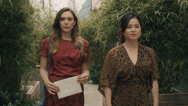 Leigh (Elizabeth Olsen) walks with her sister Jules (Kelly Marie Tran) in