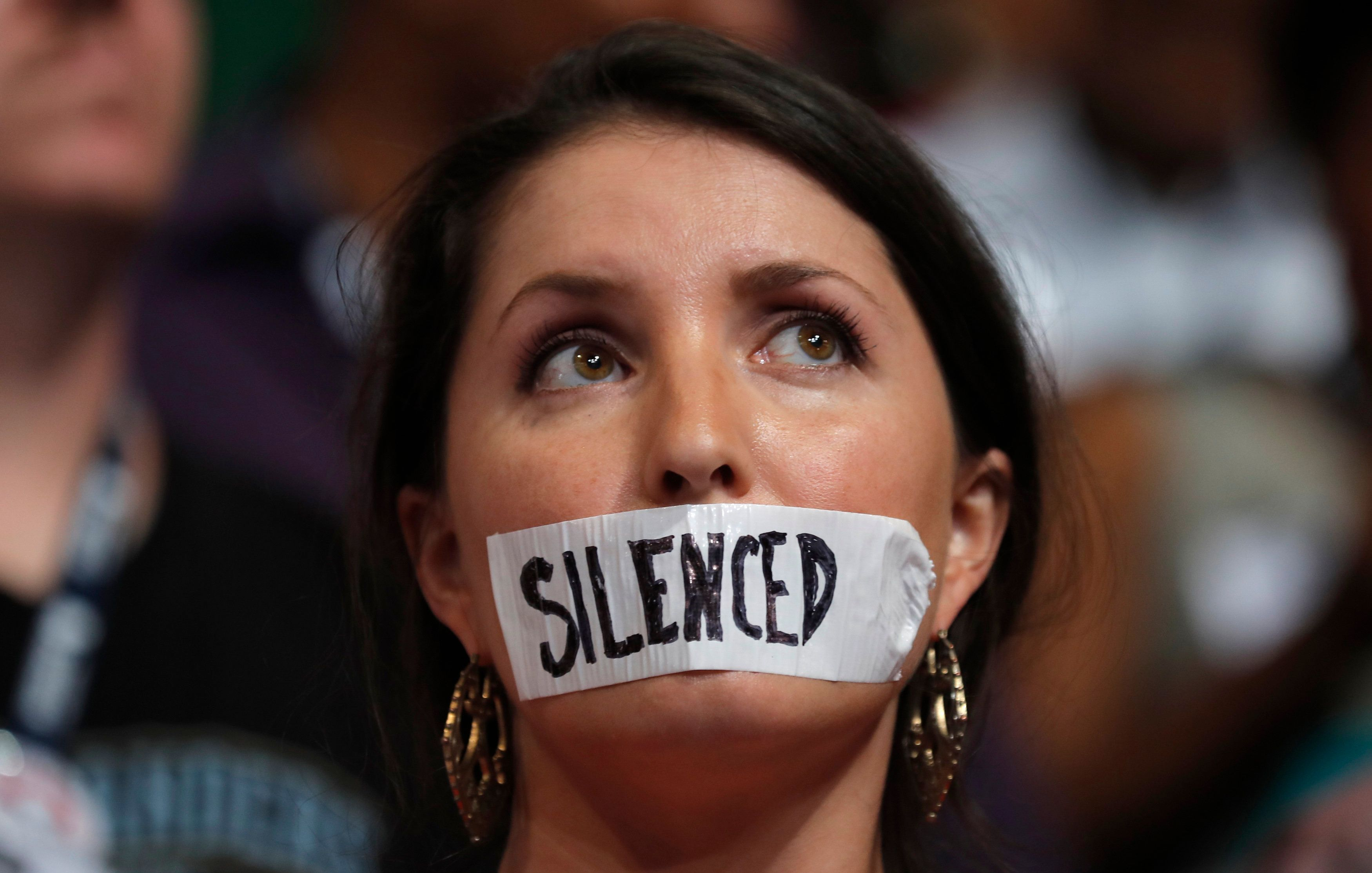A supporter of former Democratic U.S. presidential candidate Bernie Sanders wears tape across her mouth in protest on the floor at the Democratic National Convention in Philadelphia, Pennsylvania, U.S., July 25, 2016. REUTERS/Jim Young