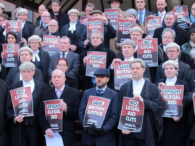 Some of the legal representatives and supporters outside Birmingham Crown Court as barristers around...