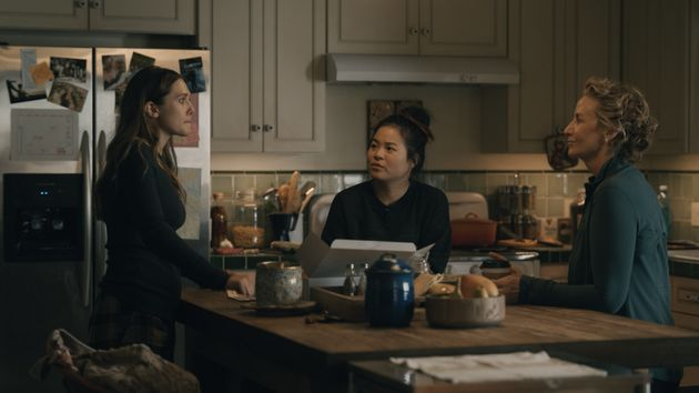 Leigh, Jules and their mother, Amy (Janet McTeer), talk in the kitchen in
