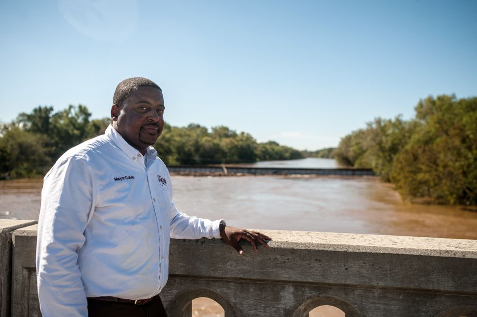 In Fayetteville, Mayor Mitch Colvin stands atop the Person Street bridge on Tuesday, which spans the Cape Fear River.<i></i><
