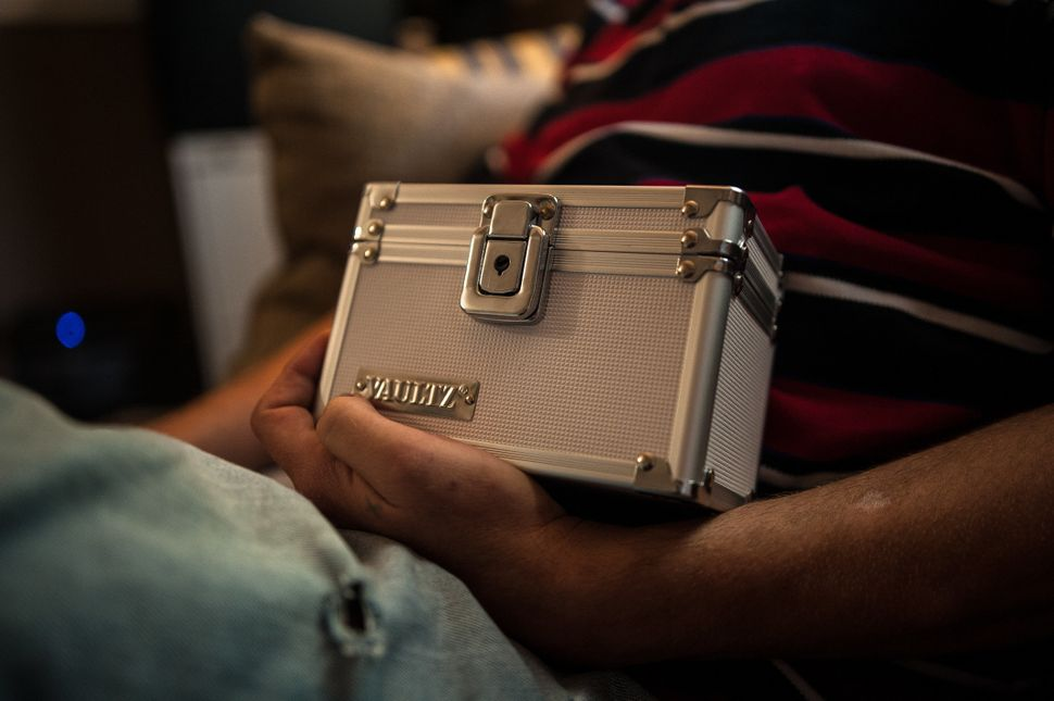 Shaun Lewis of Lumberton holds his lockbox, which he keeps his take-home medication in.<i></i><i></i>