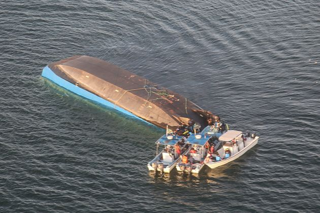 An aerial image shows the capsized ferry MV Nyerere which killed hundreds of people in Lake Victoria,...