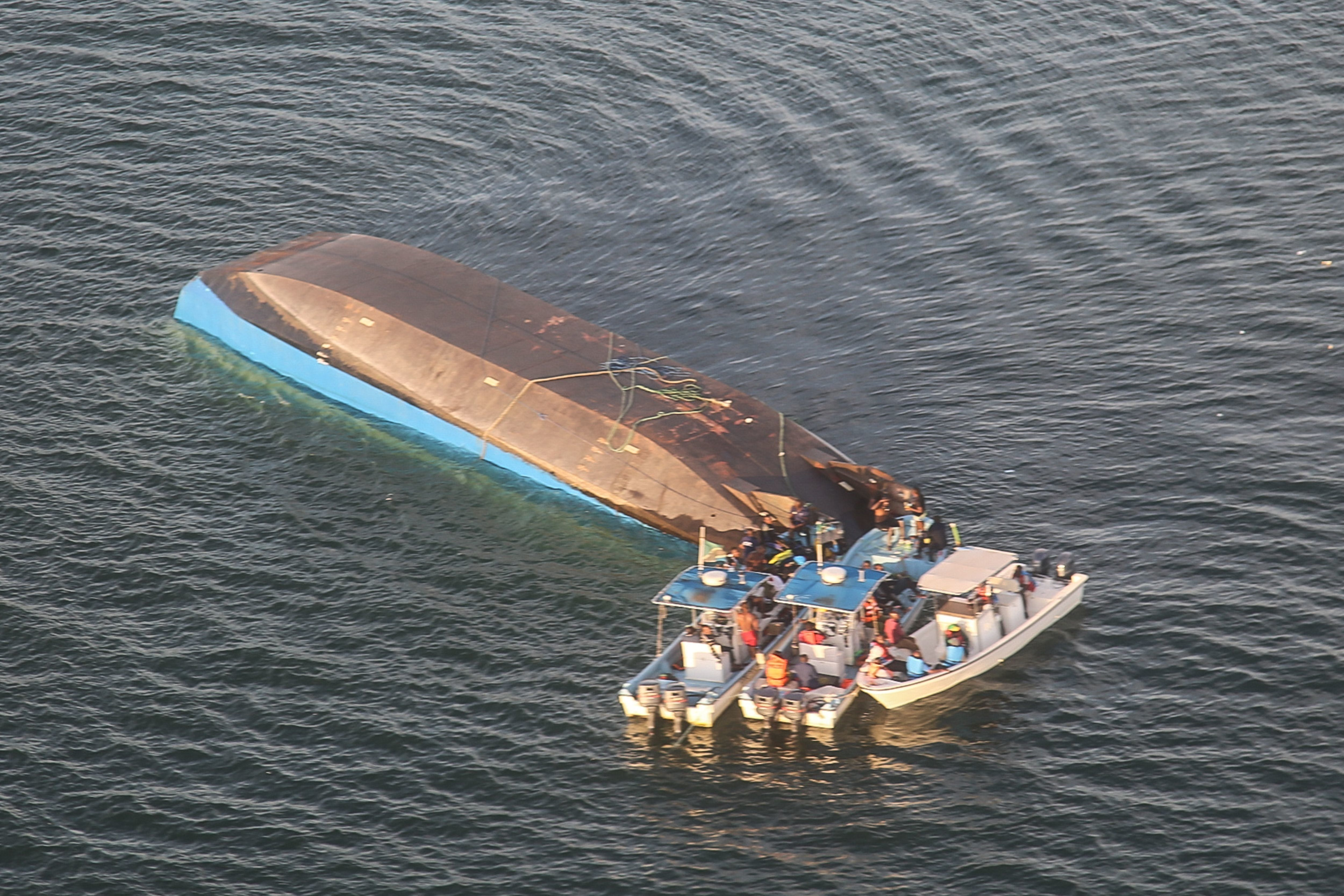 An aerial image shows the capsized ferry MV Nyerere which killed 131 people in Lake Victoria, Tanzania, on September 21, 2018. - Tanzanian President John Magufuli on September 21 ordered the arrest of the management of a ferry that capsized in Lake Victoria, as the death toll climbed to 131 and rescue workers pressed on with the search to find scores more people feared drowned. (Photo by Stringer / AFP)        (Photo credit should read STRINGER/AFP/Getty Images)