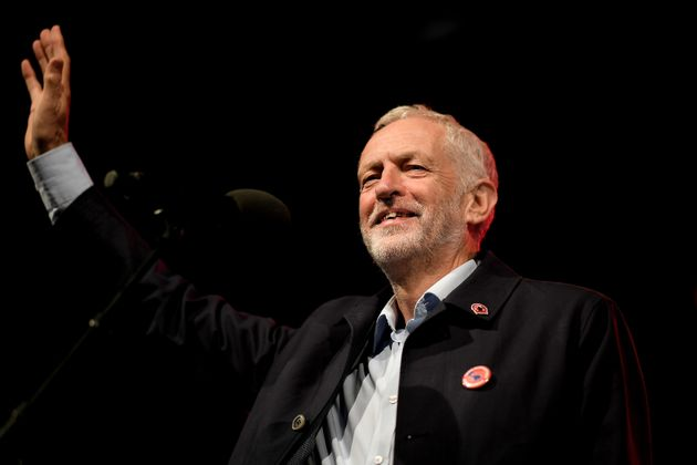 Jeremy Corbyn waves to the gathered party faithful ahead of his address during the Labour Party Rally at Pier Head on September 22, 2018 in Liverpool.