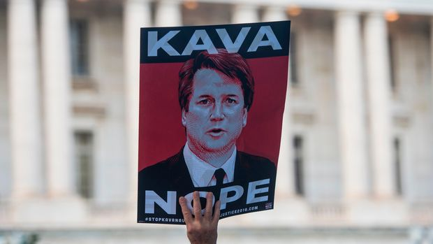Protesters hold up signs during a rally near Capitol Hill against the confirmation hearing for Judge Brett Kavanaugh to be an Associate Justice on the US Supreme Court in Washington, DC, on September 4, 2018. - President Donald Trump's newest Supreme Court nominee Brett Kavanaugh is expected to face punishing questioning from Democrats this week over his endorsement of presidential immunity and his opposition to abortion. (Photo by Andrew CABALLERO-REYNOLDS / AFP)        (Photo credit should read ANDREW CABALLERO-REYNOLDS/AFP/Getty Images)