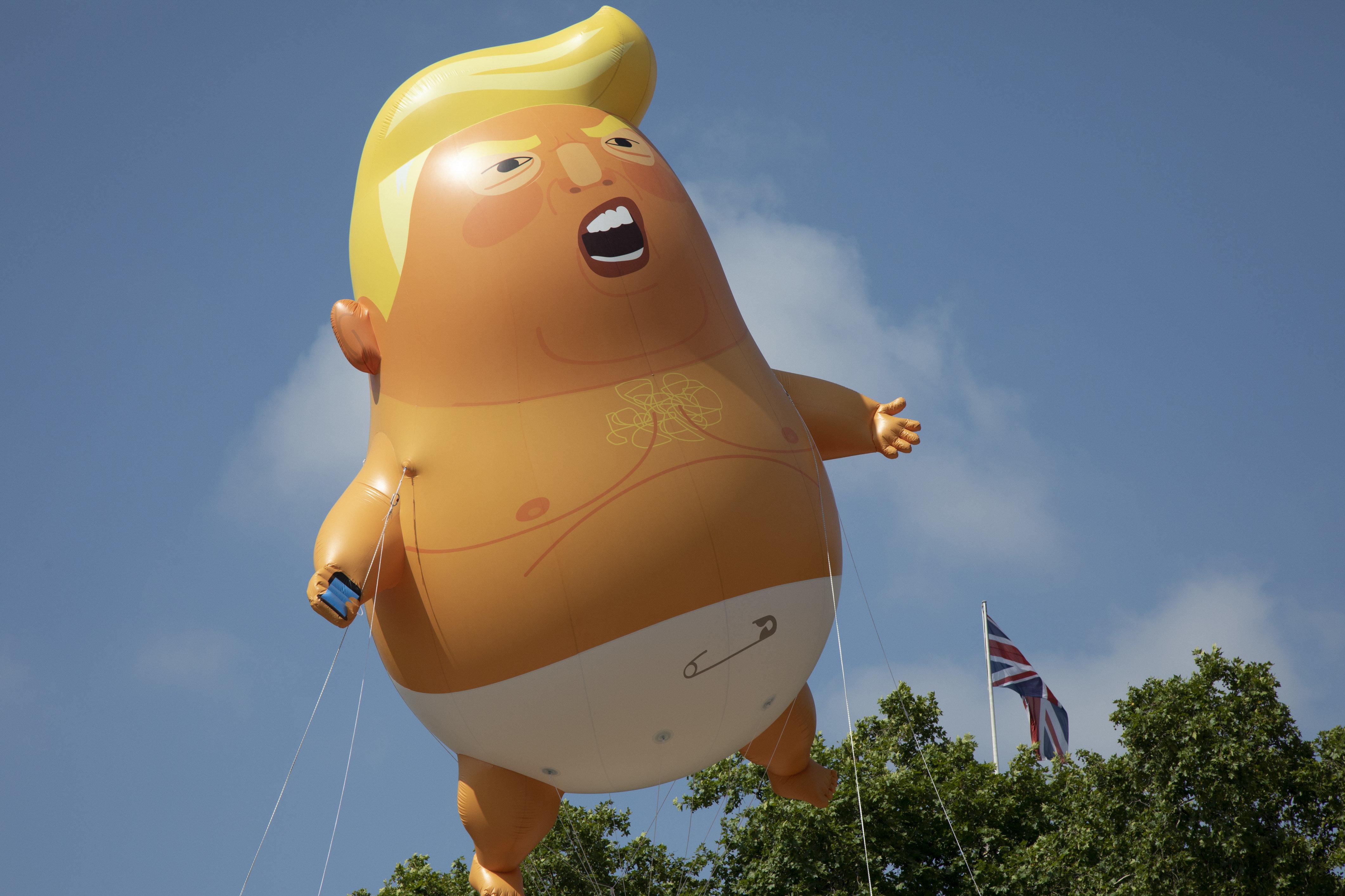 huffingtonpost.com - Mary Papenfuss - Baby Trump Blimp Highlights Puerto Rico Rally Near Mar-a-Lago