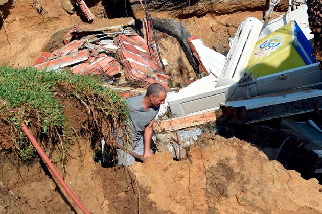 A picture taken on September 23, 2018, in the Tunisian coastal governante of Nabeul shows a man digging...