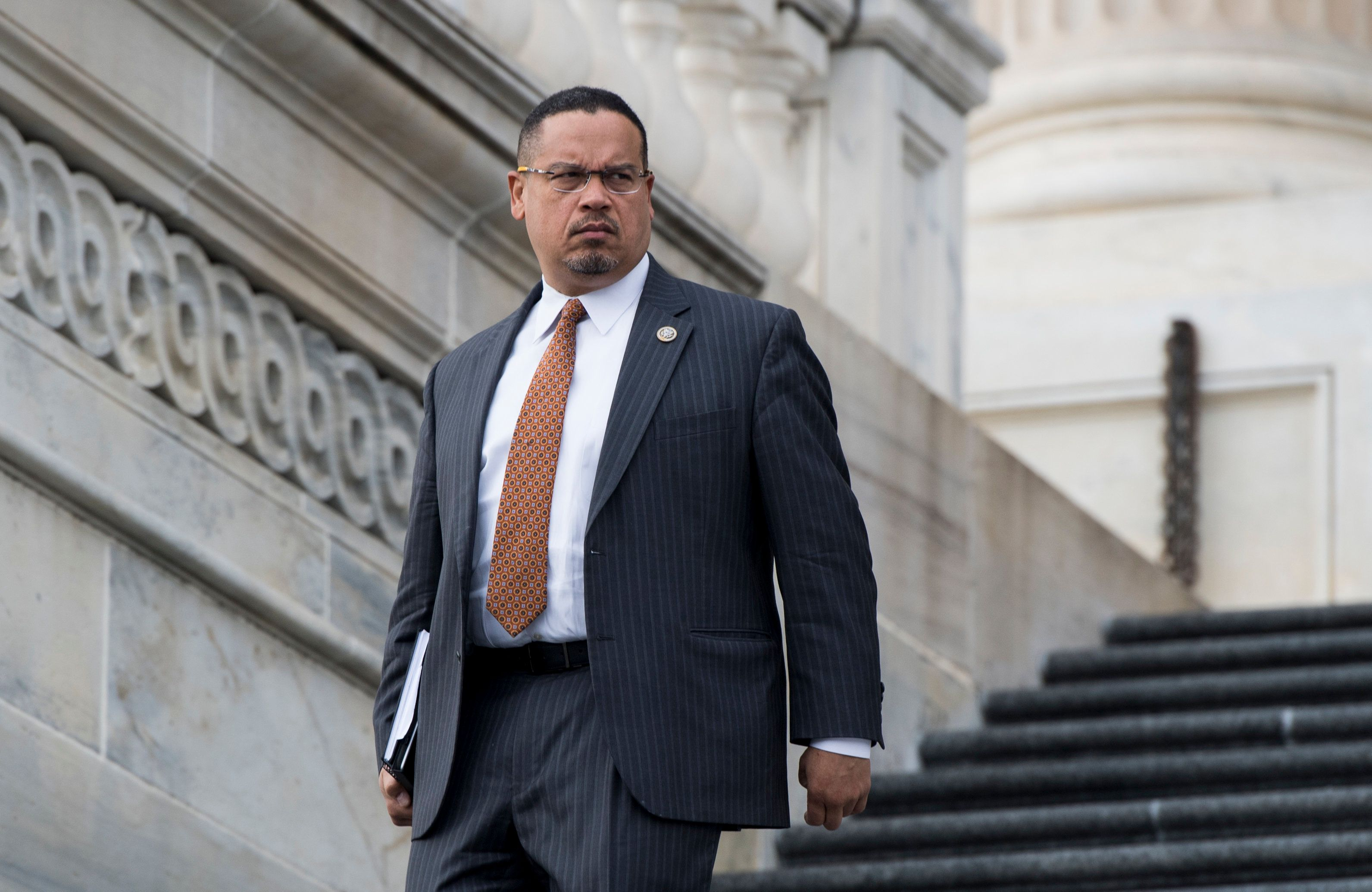 UNITED STATES - JANUARY 11: Rep. Keith Ellison, D-Minn., walks down the House steps after the final votes of the week on Thursday, Jan. 11, 2018. (Photo By Bill Clark/CQ Roll Call)