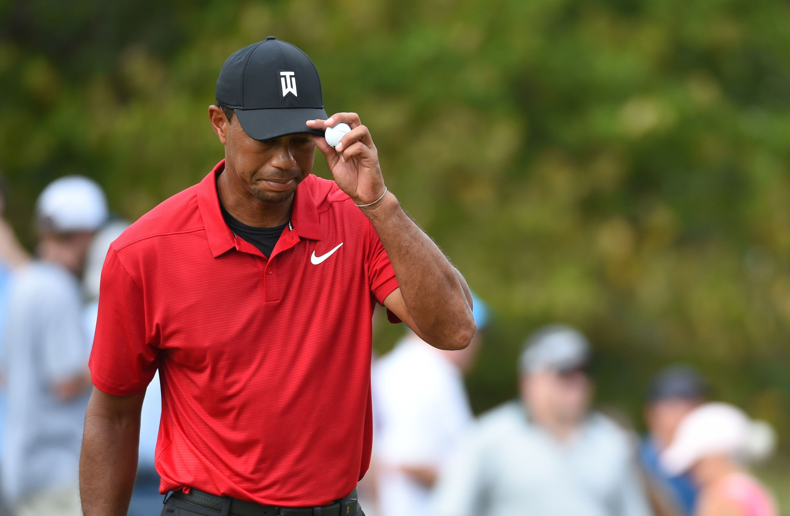 Sep 23, 2018; Atlanta, GA, USA;  Tiger Woods on reacts after his putt on the second green during the final round of the Tour Championship golf tournament at East Lake Golf Club. Mandatory Credit: John David Mercer-USA TODAY Sports