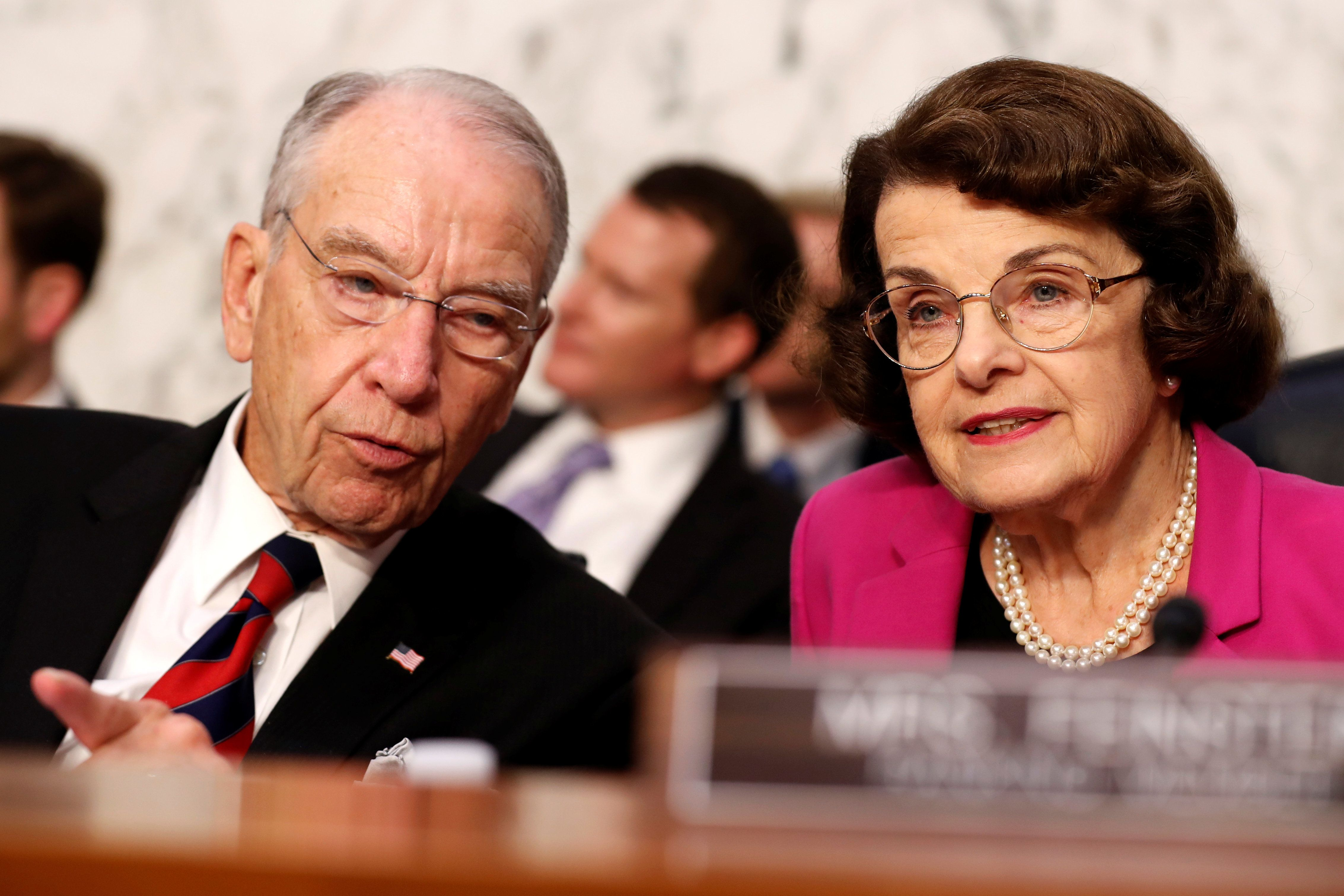 U.S. Senators Chuck Grassley (R-IA) and Dianne Feinstein (D-CA) talk together during U.S. Supreme Court nominee Judge Brett Kavanaugh's U.S. Senate Judiciary Committee confirmation hearing on Capitol Hill in Washington, U.S., September 4, 2018. REUTERS/Joshua Roberts