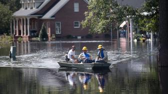 CONWAY, SC - SEPTEMBER 23: People navigate floodwaters caused by Hurricane Florence near the Waccamaw River on September 23, 2018 in Conway, South Carolina. Floodwaters are expected to continue to rise in Conway over the next two days. (Photo by Sean Rayford/Getty Images)