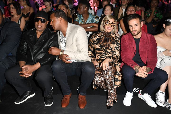 Cardi B and Liam Payne sitting next to each other at the show.