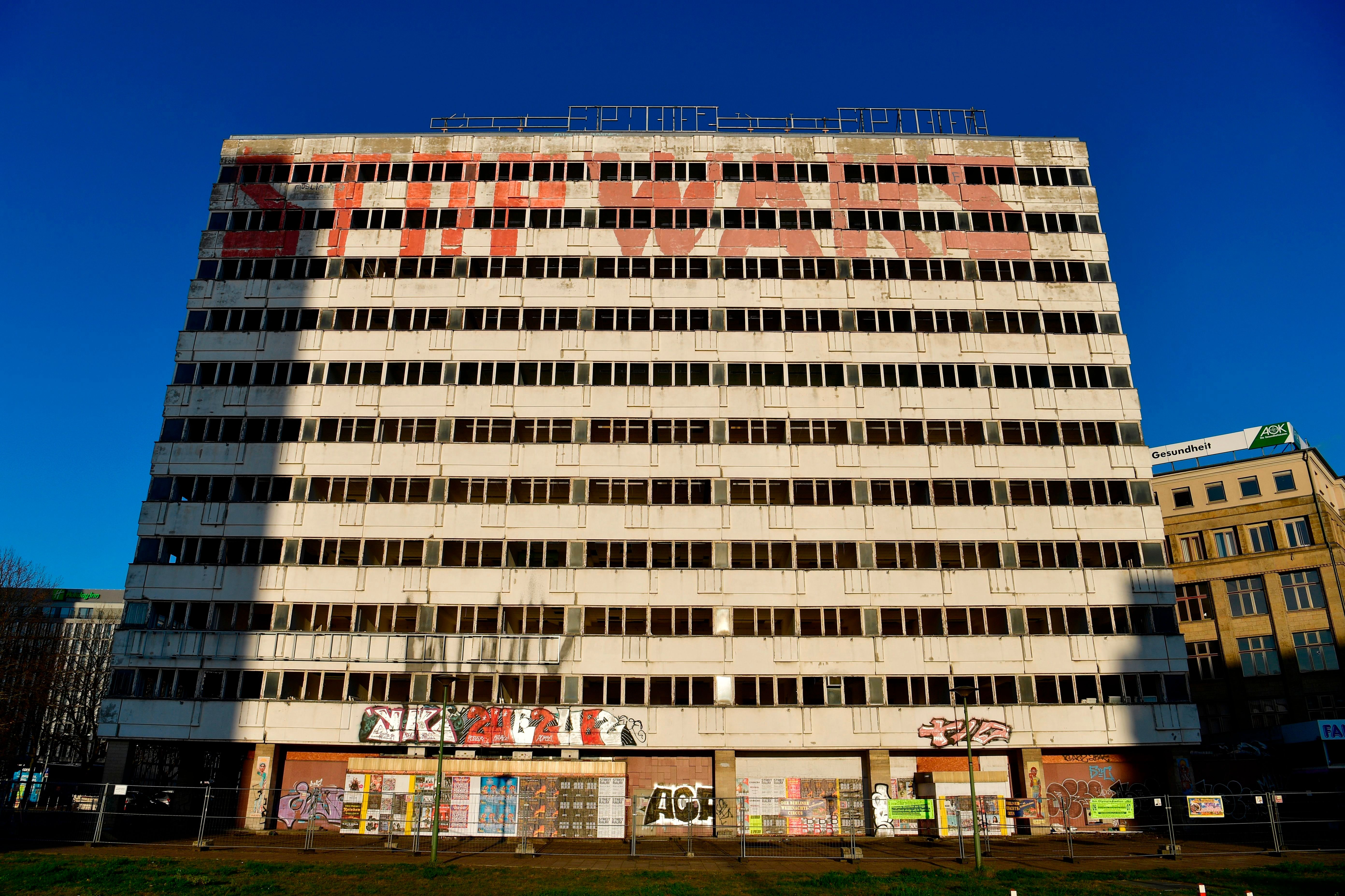 View of the former Haus der Statistik building in Berlin's Alexanderplatz district, taken on December 29, 2017. The 11-storey-high building complex, completed in 1970 to house east Germany's national institute for statistics, was recently bought by the city of Berlin for an estimated EUR 57 million. The complex, which boasts 55.000 square meters of space, has been empty since 2008. / AFP PHOTO / John MACDOUGALL        (Photo credit should read JOHN MACDOUGALL/AFP/Getty Images)