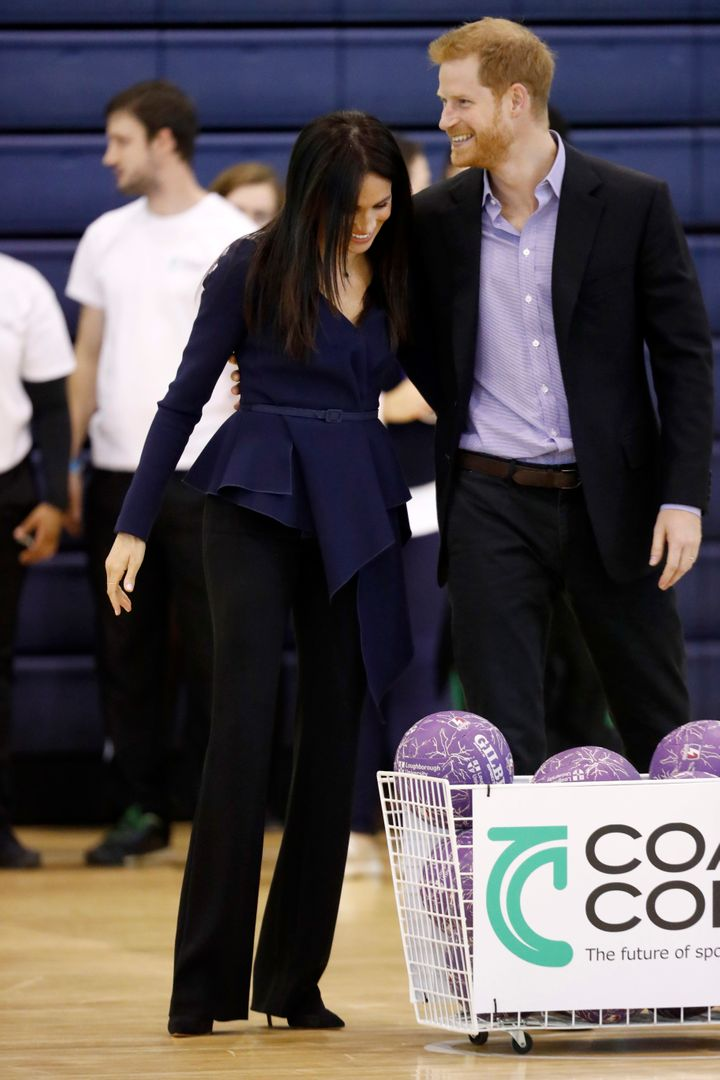 The Duke and Duchess of Sussex sharing a laugh at the Coach Core Awards on Sept. 24.