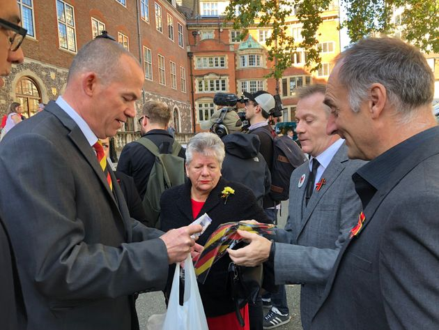Tony Farrugia (left) shows blood campaign ties worn by many to the inquiry opening this morning to Mark...