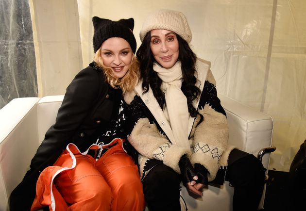 Madonna and Cher sit together during the Women's March on Washington on Jan. 21,