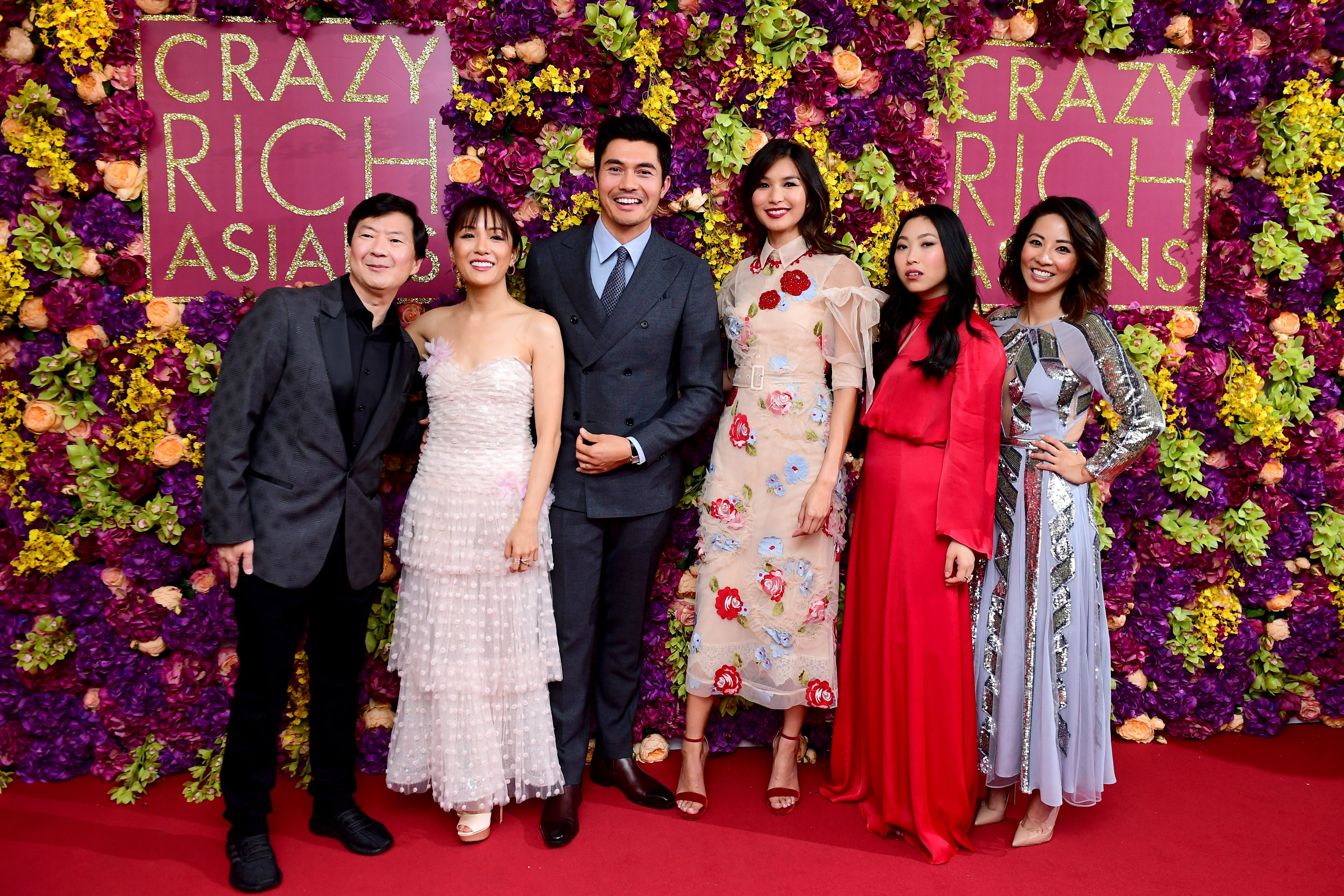 (From left to right) Ken Jeong, Constance Wu, Henry Golding, Gemma Chan, Awkwafina and Jing Lusi attending the Crazy Rich Asians Premiere held at Ham Yard Hotel, London. (Photo by Ian West/PA Images via Getty Images)