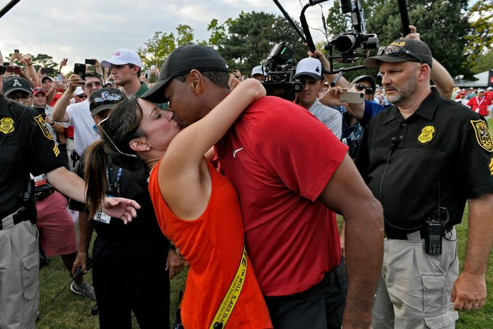Tiger Woods and girlfriend Erica Herman kiss after the final round Sunday of the Tour Championship in Atlanta.