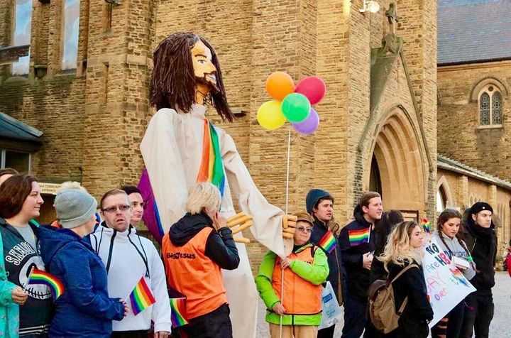 """Protesters stand with a """"Big Jesus"""" figure outside the Lancashire Festival of Hope, which took place from Sept. 21 to 23 in B"""