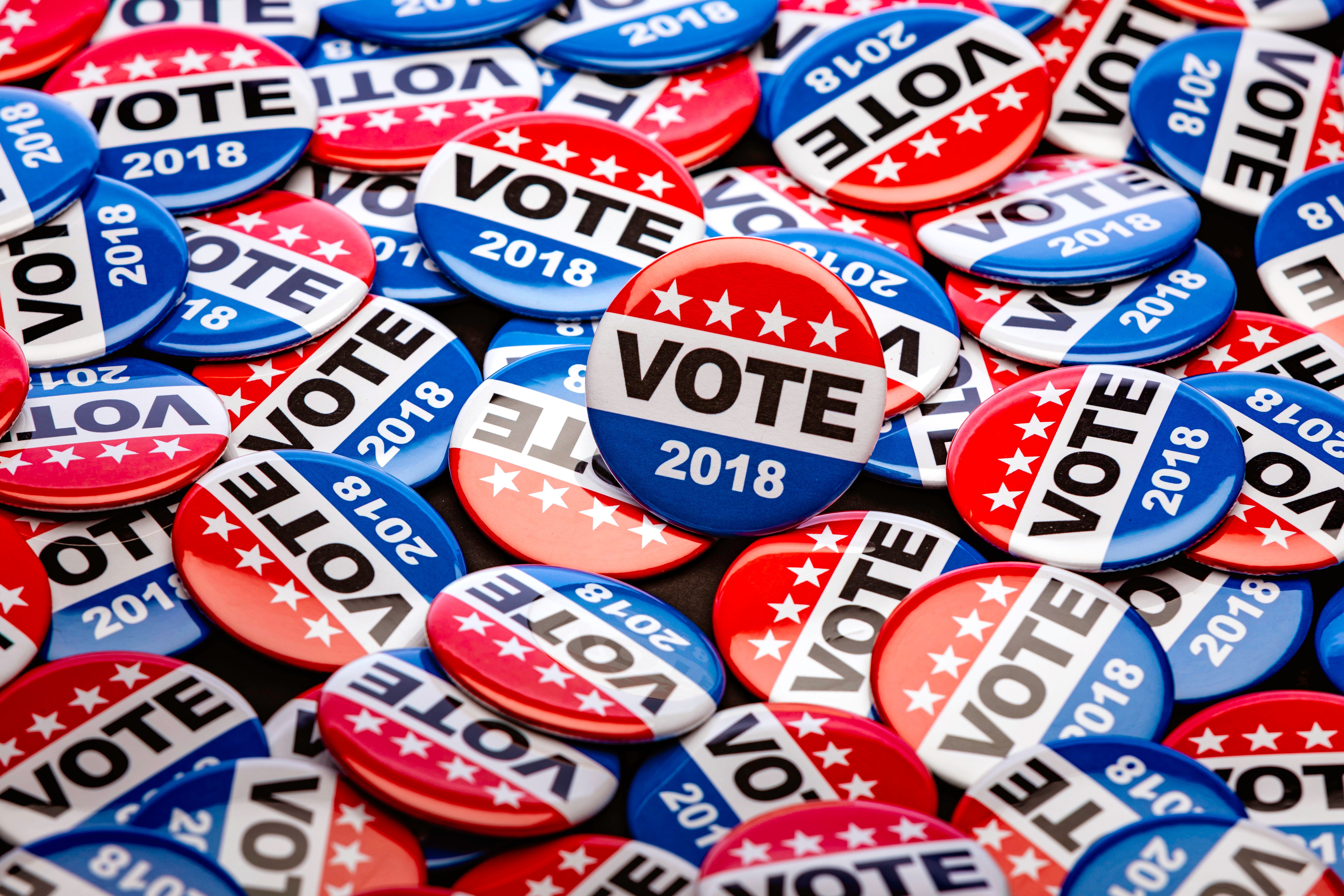 High quality stock photo of patriotic voting buttons for the mid term election, some with copy space on white or an American Flag.
