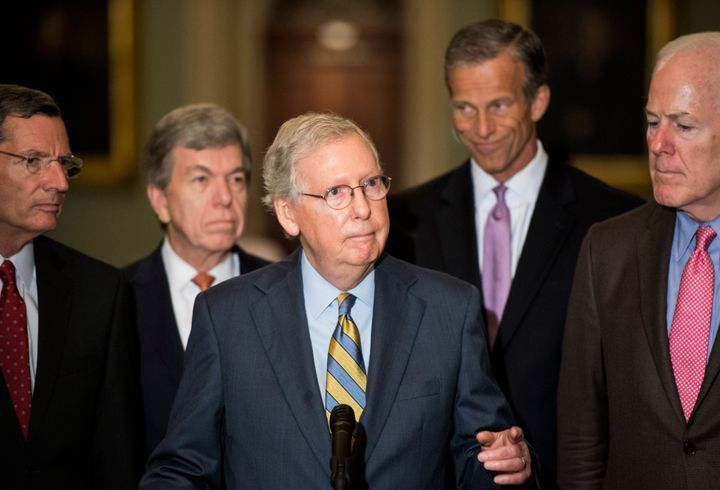 "Senate Majority Leader Mitch McConnell, center, called the latest accusation against Supreme Court nominee Brett Kavanaugh ""a"