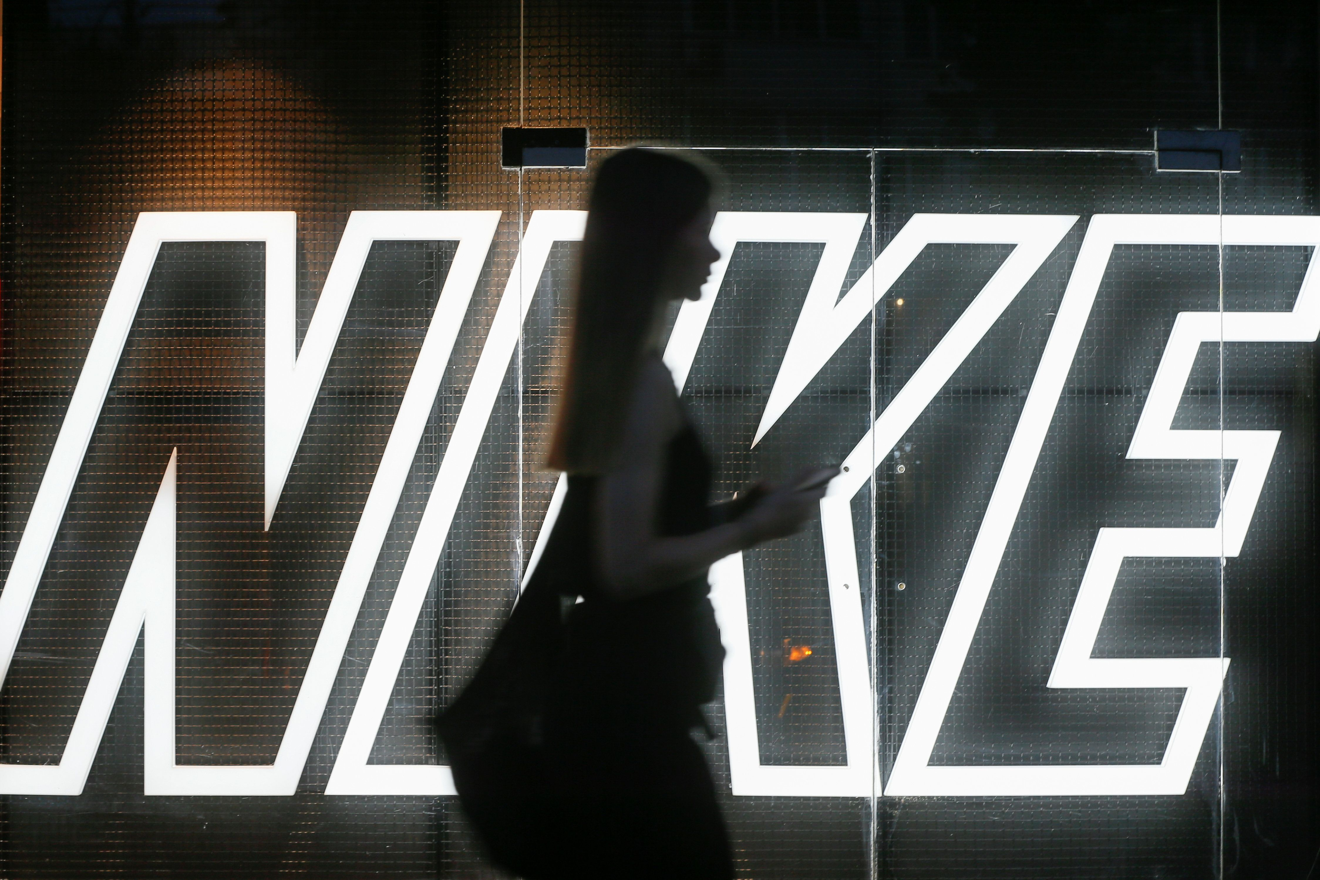 A woman walks past a Nike store in central Kiev, Ukraine August 14, 2018. Picture taken August 14, 2018.  REUTERS/Valentyn Ogirenko
