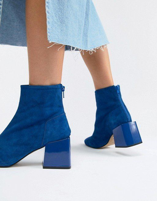 The block heeled cobalt blue boot is hard not to love. The sculptural heel is also a great choice for those of us who care about comfort first. Whether you're wearing head-to-toe yellow or black on black, this boot will pop.Rome Leather Ankle Boots, sizes 3-8 available, £70, ASOS.