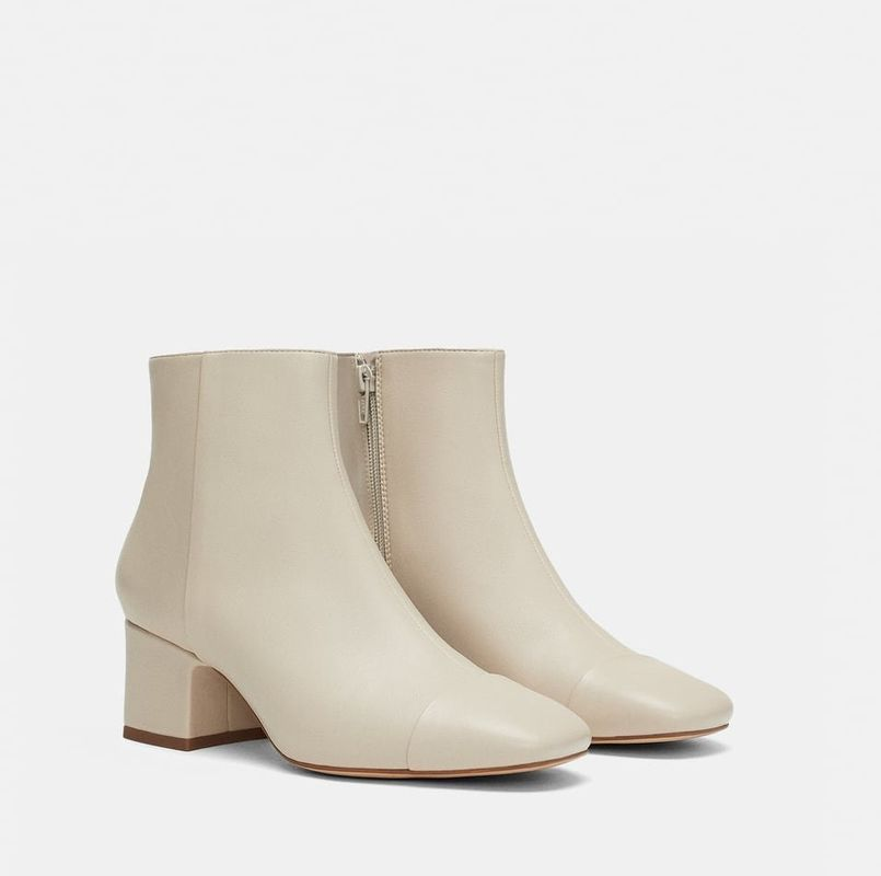 Who knew a toe-cap could be so desirable? Maybe it's the off white appeal too. All we know is that we'd really like this sculpted pair of ankle boots to start off our autumn.Mid-Heel Ankle Boots With Toecap, sizes 2-9 available, £29.99, Zara.