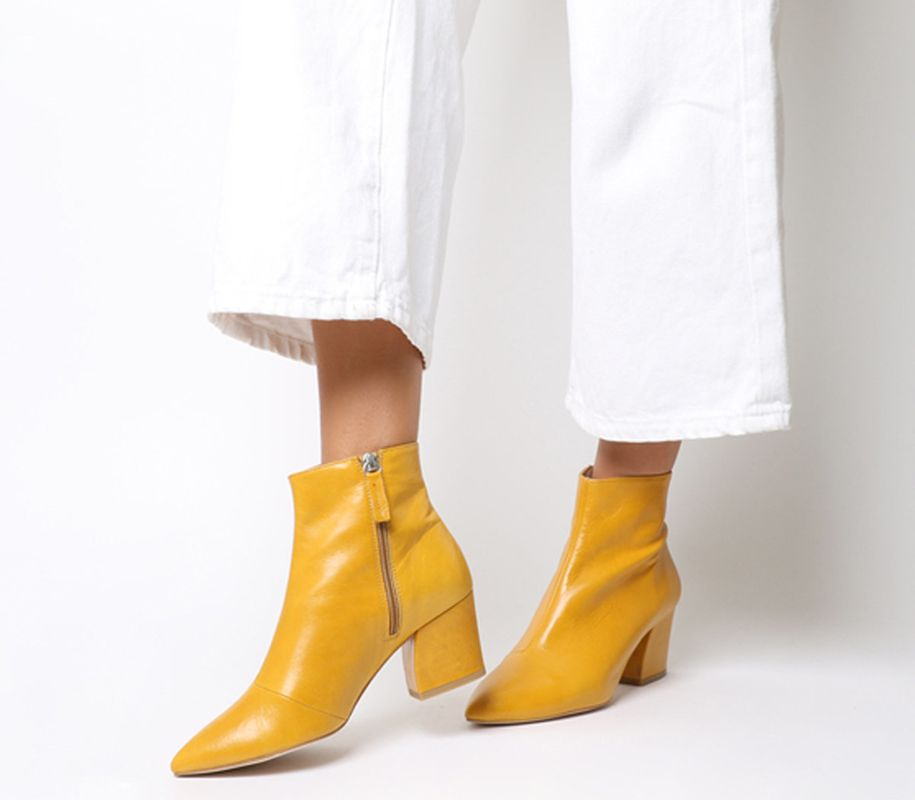 Like lilac, mustard yellow has been a key colour trend this past season. Just because the days are shorter, doesn't mean it's time to say good-bye to what's typically worn in the summertime.Aubergine Curved Heel Ankle Boots Mustard Leather, sizes 3-8 available, £89, Office.