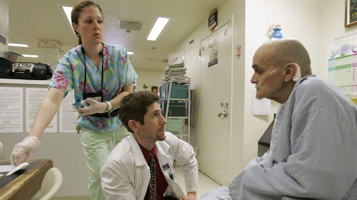 Dr. Joseph Bick, center, talks to hepatitis C patient Richard Carreiro, as nurse Laura Escareno-Scarrott watches in a Vacavil