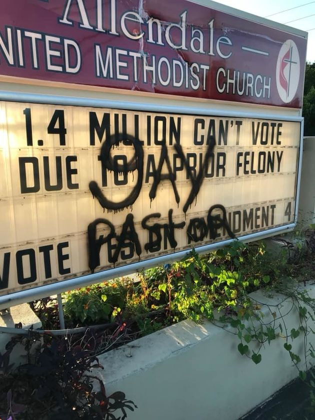 The vandalized church sign was discovered Monday