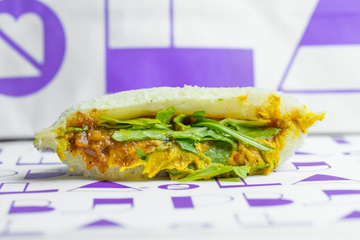 "PBJ.LA's ""Indian"" sandwich is made with curried cashew butter, spicy mango chutney, arugula and sliced daikon radish."