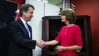 Brett Kavanaugh, U.S. Supreme Court associate justice nominee for U.S. President Donald Trump, left, shakes hands with Senator Lisa Murkowski, a Republican from Alaska, at her office on Capitol Hill in Washington, D.C., U.S., on Thursday, Aug. 23, 2018. Kavanaughdidn't say whether he believed a sitting president was subject to a subpoena or criminal indictment, SenatorDick Durbin said after an earlier meeting with the nominee. Photographer: Al Drago/Bloomberg via Getty Images