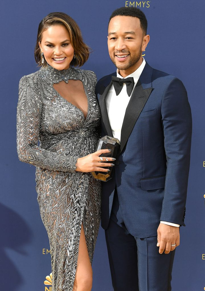 John Legend, Chrissy Teigen arrives at the 70th Emmy Awards.