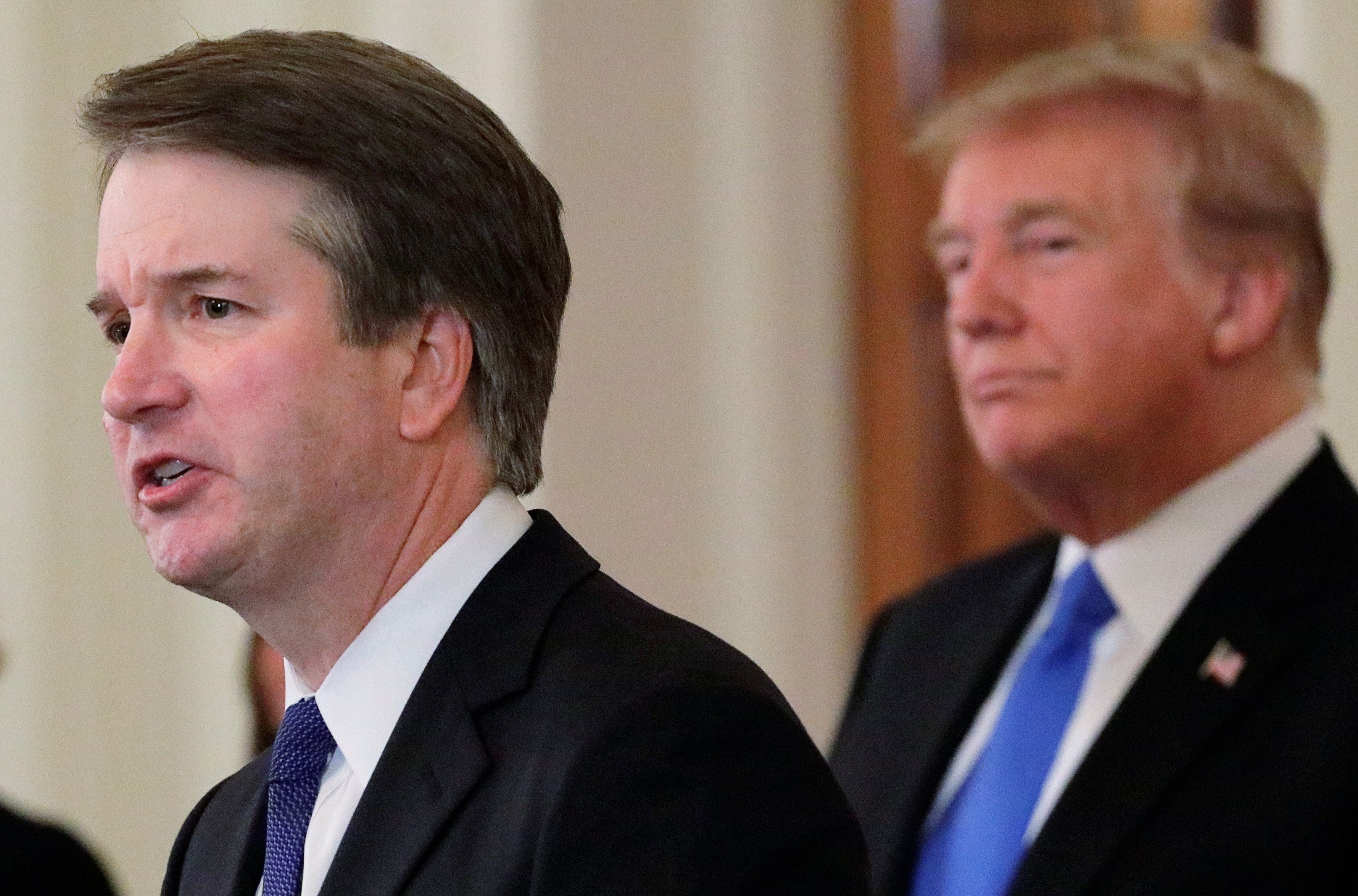 U.S. President Donald Trump listens to his nominee for the U.S. Supreme Court Brett Kavanaugh speak during his nomination announcement in the East Room of the White House in Washington, U.S., July 9, 2018. Picture taken July 9, 2018. REUTERS/Jim Bourg